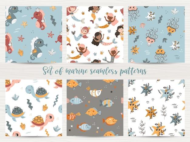 Vectorset van naadloze patronen met zeemeerminnen en zeedieren