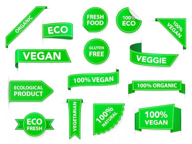 Veganistische badges. eco biologische vegetarische tags, veganistische gezondheidsdieetetiketten, vegetarische producten groene insignes, gezonde voedingemblemen met geplaatste lintenpictogrammen. gezond eten verpakking stickers