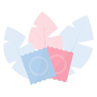 Veilig seksueel gedrag anticonceptie twee condooms op een achtergrond van bladeren