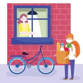 Veilige levering thuis tijdens coronavirus covid-19, koeriersman met masker en boodschappentas en vrouw die uit het raam kijkt