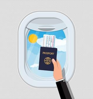 Venster vanuit het vliegtuig. hand met paspoort en ticket. patrijspoort luik. patrijspoort luik. lucht, zon en wolken. vliegreis of vakantie. vectorillustratie in vlakke stijl