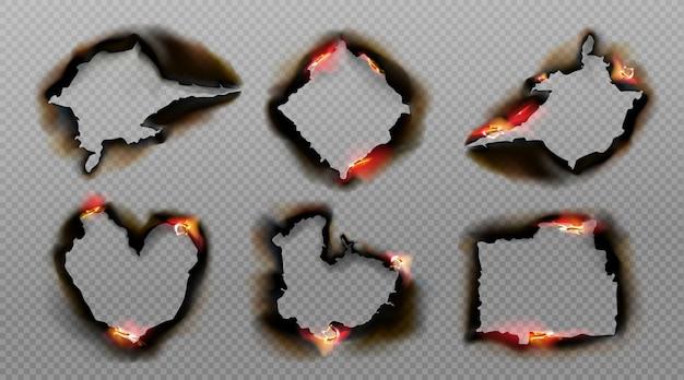 Verbrande gaten in papier met vuur en zwarte as