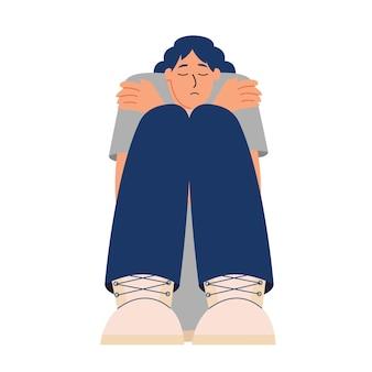 Verdrietig meisje zit en knuffelt zichzelf eenzaamheid depressie angst concept