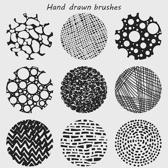 Verfborstelreeks, abstracte bellen getrokken hand, texturen en borstels. lineaire tribale ornamenten, artistieke verzameling elementen golvende lijnen gemaakt met inkt.