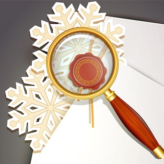 Vergrootglas en sneeuwvlokken met papieren