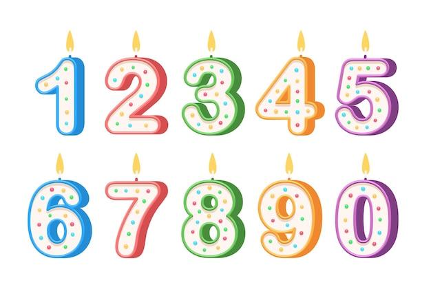 Verjaardagskaarsen in de vorm van getallen op wit wordt geïsoleerd