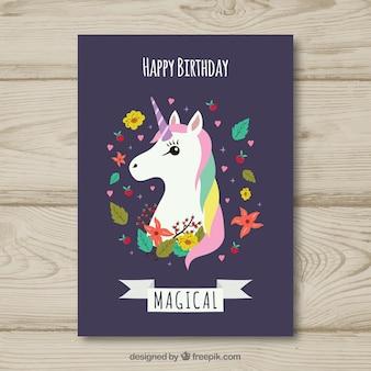 Verjaardagskaart met een eenhoorn en bloemen