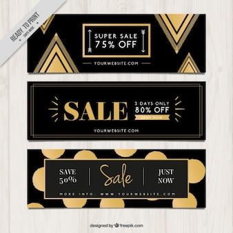 Verkoop donkere banners met gouden elementen