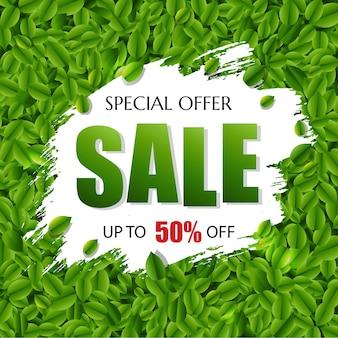 Verkoopbanner met groene bladerenillustratie als achtergrond