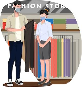 Verkoopmeisje dat een koper dient die lange broek bij modewinkel wil kopen