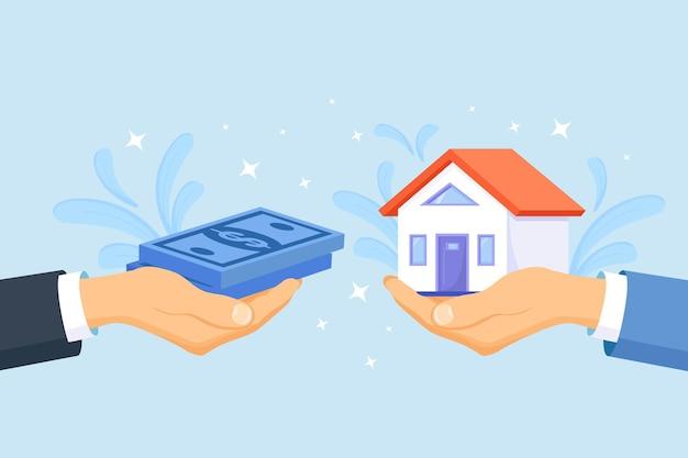 Verkoper geeft huis aan klant. koper brengt geld contant voor huisaankoop, hypotheek. vastgoedlening, huur, onroerend goed kopen