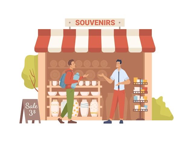 Verkoper toont souvenirs aan koper in marktwinkel