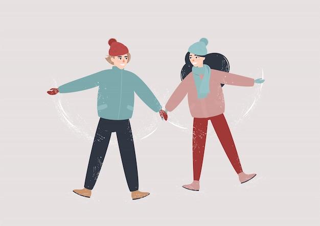 Verliefde paar ligt in de sneeuw en houdt elkaars handen vast