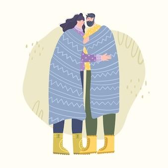 Verliefde paar staat in een knuffel in de frisse lucht.