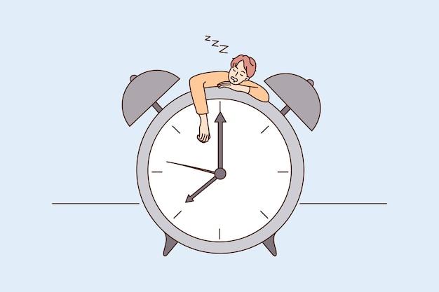 Vermoeide man valt in slaap op enorme klok