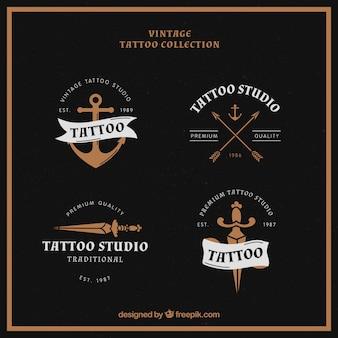 Verpakking van vier tattoo logo's in vintage stijl