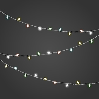 Verschillende kleur verlichting garland vector ingesteld op donkere achtergrond. kerstverlichting vector collectie. gloeiende lampen vect of set