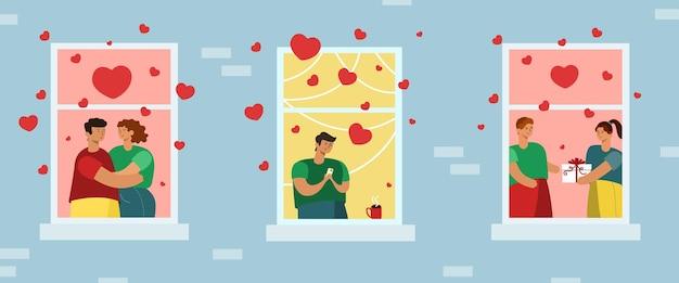 Verschillende mensen vieren valentijnsdag in de ramen van het huis.