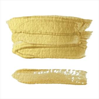 Verschillende moderne flikkerende penseelstreken van gouden verf op een witte achtergrond. ontwerpelement.
