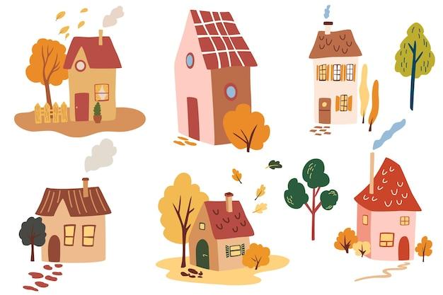 Verschillende schattige huizen bomen en bladeren cartoon handgetekende set van gezellige kleine herenhuizen met rook