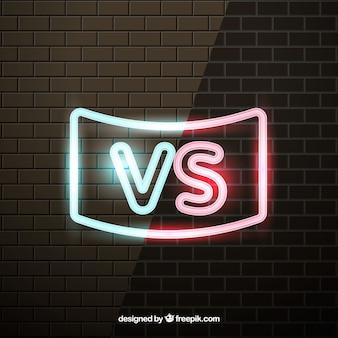 Versus met neon effect op bakstenen muur