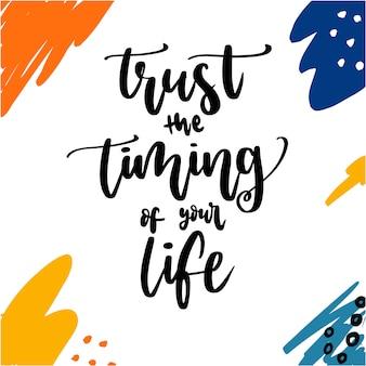 Vertrouw op de timing van je leven belettering met aquarel vlekken