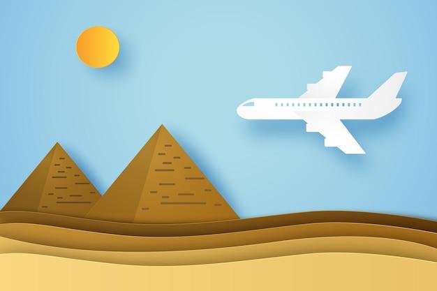 Vervoer met vliegtuig dat naar piramide vliegt in papieren kunststijl