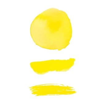 Verzameling gele aquarel penseelstreken en vlek geïsoleerd op een witte achtergrond