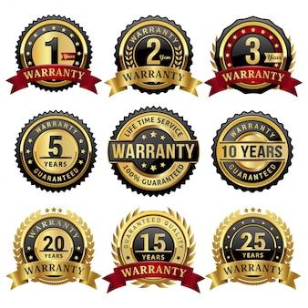 Verzameling gouden garantiejaren badges en labels
