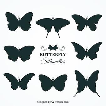 Verzameling van acht vlindersilhouetten