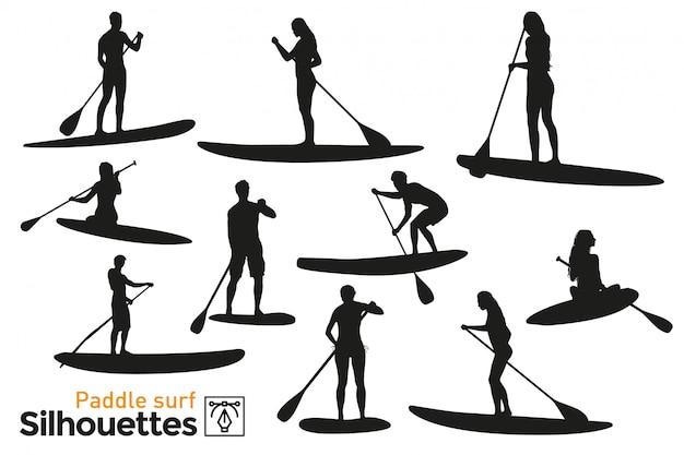 Verzameling van geïsoleerde paddle surf silhouetten. premie