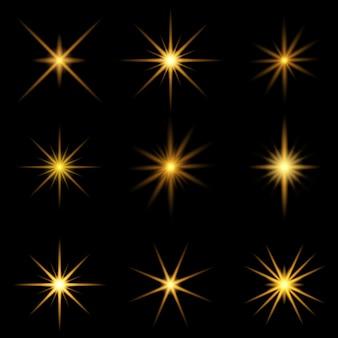 Verzameling van gouden starbursts Gratis Vector
