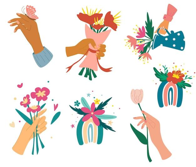 Verzameling van handen met boeketten of trossen bloeiende bloemen. bundel van bloemen decoratieve designelementen. kleurrijke regenbogen met bloemen. romantisch cadeau. vector illustratie.
