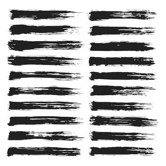 Verzameling van handgeschilderde zwarte grunge penseelstreken
