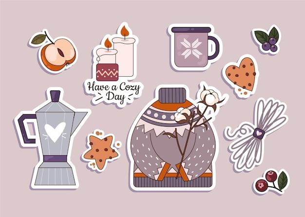 Verzameling van hygge-stickers in plat ontwerp