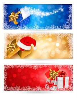 Verzameling van kerst achtergronden met geschenkdozen en sneeuwvlokken. illustratie.