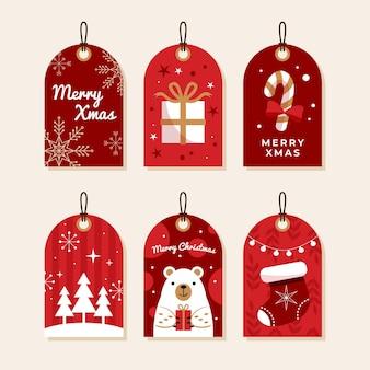 Verzameling van kerstetiketten in plat design