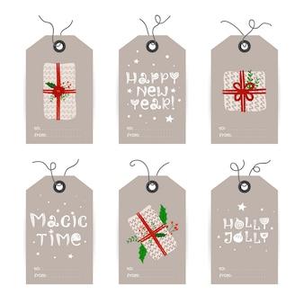 Verzameling van kerstmarkeringen met geschenken en vakantiewensen.