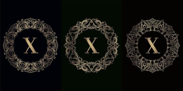 Verzameling van logo eerste x met luxe mandala ornament frame