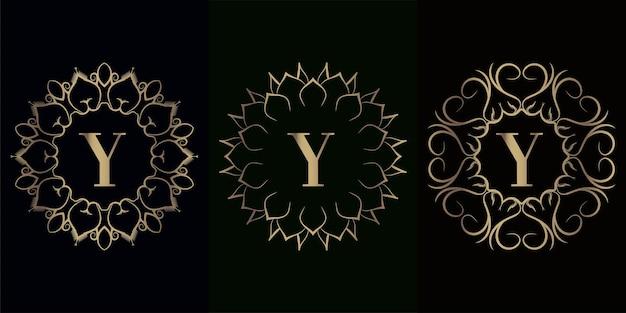 Verzameling van logo eerste y met luxe mandala ornament frame