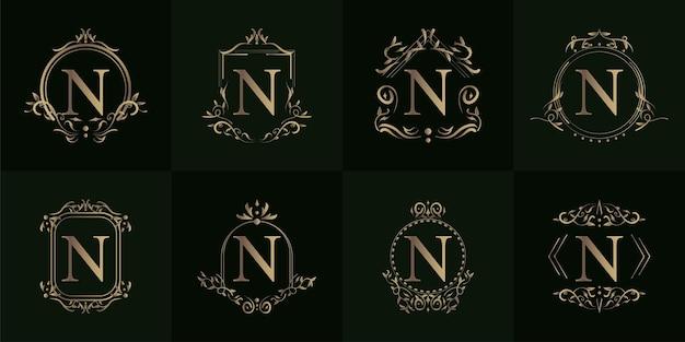 Verzameling van logo initiaal n met luxe ornament of bloemframe