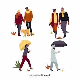 Verzameling van mensen lopen in de herfst