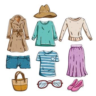 Verzameling van modieuze kleding van de vrouw met gekleurde hand getrokken of doodle stijl