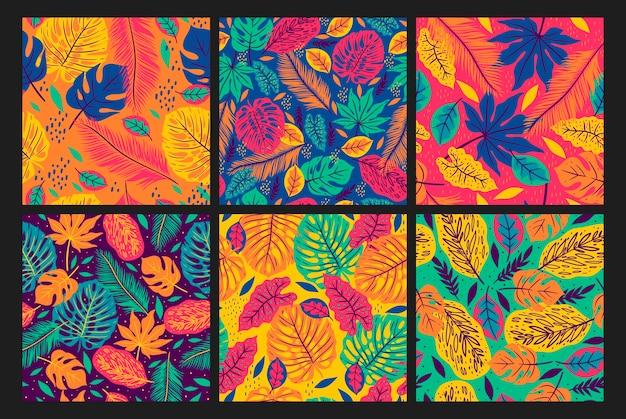 Verzameling van naadloze patronen met tropische bladeren.