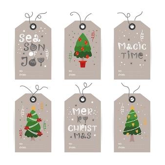 Verzameling van tags met kerstboom en vakantiewensen. afdrukbare kaartsjablonen.