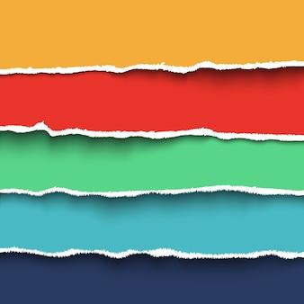 Verzameling van vier kleurrijke stukjes gescheurd papier met gescheurde randen.