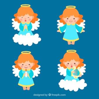 Verzameling van vier rode haired kerst engelen