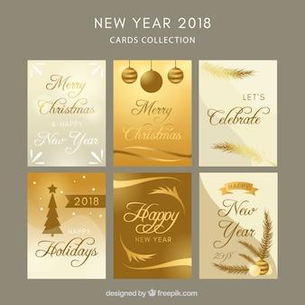 Verzameling van zes gouden nieuwjaarskaarten