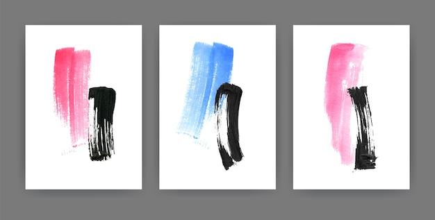 Verzameling verticale minimalistische posters met blauwe, zwarte en roze verfsporen