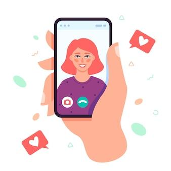 Video-oproep concept. videogesprek met geliefde. mannenhand met smartphone met vriendin op scherm.